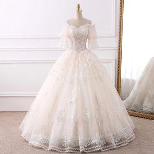 Elegante Champagner Brautkleider 2018 Ballkleid Off Shoulder 1/2 Ärmel Rückenfreies Applikationen Mit Spitze Perlenstickerei Perle Quaste Rüschen Lange