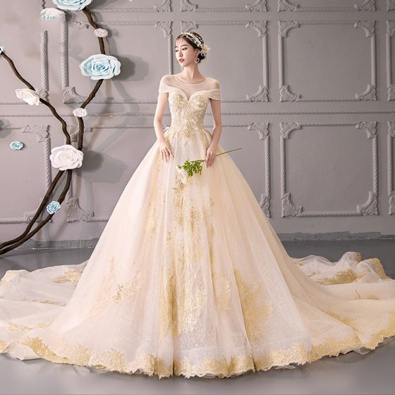 Luxury   Gorgeous Champagne See-through Wedding Dresses 2019 Ball Gown  Scoop Neck Short Sleeve Backless Gold Appliques Lace Beading Glitter ... f0977f69efa5