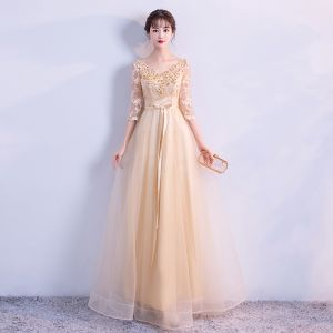 Elegant Gold Evening Dresses  2018 Empire V-Neck 3/4 Sleeve Appliques Lace Sequins Beading Sash Floor-Length / Long Ruffle Backless Formal Dresses