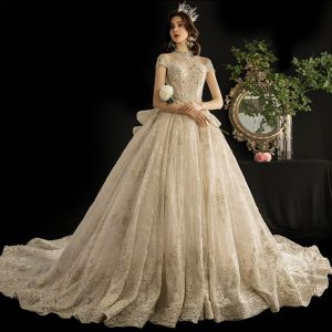 Luxury / Gorgeous Vintage / Retro Champagne See-through Wedding Dresses 2019 Ball Gown High Neck Short Sleeve Glitter Tulle Appliques Lace Beading Cathedral Train