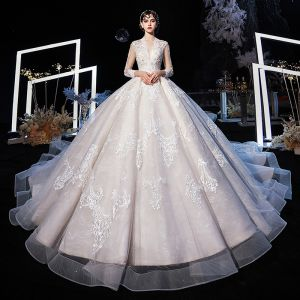Illusion Champagne See-through Wedding Dresses 2020 Ball Gown V-Neck 3/4 Sleeve Backless Appliques Lace Beading Cathedral Train Ruffle