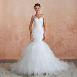 Luxus / Herrlich Ivory / Creme Brautkleider / Hochzeitskleider 2020 Meerjungfrau V-Ausschnitt Ärmellos Rückenfreies Perlenstickerei Kapelle-Schleppe Rüschen