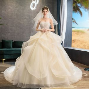 Best Champagne Wedding Dresses 2019 Ball Gown Sweetheart Sleeveless Backless Appliques Lace Beading Chapel Train Ruffle