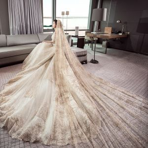 Stunning Champagne Wedding Dresses 2019 Ball Gown Off-The-Shoulder 1/2 Sleeves Backless Appliques Lace Cathedral Train Ruffle