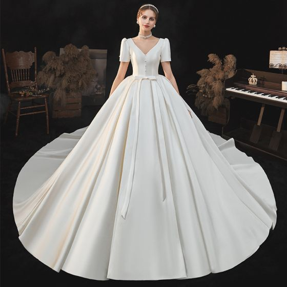 Vintage / Retro Ivory Satin Bridal Wedding Dresses 2020 Ball Gown V-Neck Puffy Short Sleeve Backless Beading Pearl Bow Cathedral Train Ruffle