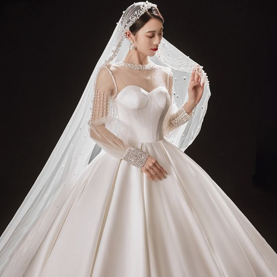 Victorian Style Ivory See-through Bridal Wedding Dresses 2021 Ball Gown High Neck Puffy Long Sleeve Backless Beading Pearl Rhinestone Cathedral Train Ruffle