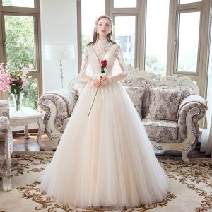 Vintage / Retro Champagne Pierced Wedding Dresses 2019 Ball Gown High Neck 1/2 Sleeves Backless Appliques Lace Court Train Ruffle