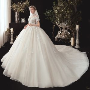 Vintage / Retro Champagne See-through Wedding Dresses 2020 Ball Gown High Neck Short Sleeve Backless Glitter Tulle Appliques Lace Beading Chapel Train Ruffle
