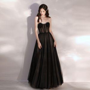 Sexy Transparentes Noire Robe De Bal 2020 Princesse Amoureux Sans Manches Perlage Longue Volants Dos Nu Robe De Ceremonie