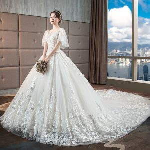 Chic / Beautiful Ivory Wedding Dresses 2018 Ball Gown Lace Appliques Scoop Neck Backless Short Sleeve Royal Train Wedding