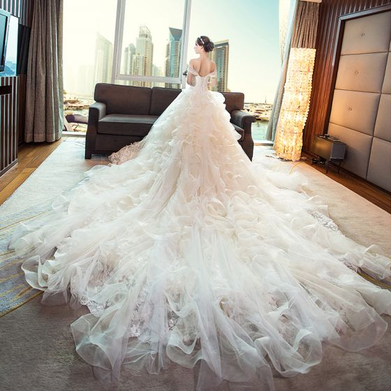 Stunning Champagne Wedding Dresses 2018 Ball Gown Lace Appliques Pearl Sequins Off-The-Shoulder Backless Sleeveless Royal Train Wedding