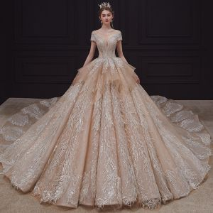 Luxury / Gorgeous Champagne Bridal Wedding Dresses 2020 Ball Gown See-through Scoop Neck Short Sleeve Backless Appliques Lace Sequins Beading Rhinestone Royal Train Ruffle