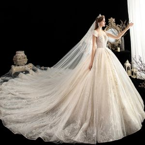 Luxury / Gorgeous Champagne See-through Wedding Dresses 2020 Ball Gown Scoop Neck Short Sleeve Backless Beading Glitter Tulle Appliques Lace Cathedral Train Ruffle