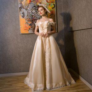 Vintage Średniowieczny Szampan Sukienki Na Bal 2021 Princessa Przy Ramieniu Bez Rękawów Skrzyżowane Pasy Koronkowe Tiulowe Aplikacje Bez Pleców Trenem Sweep Bal Sukienki Wizytowe