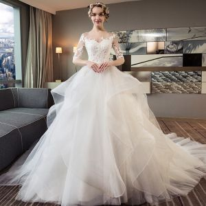 Chic / Beautiful Ivory Pierced Wedding Dresses 2018 Ball Gown Scoop Neck 1/2 Sleeves Backless Appliques Lace Cascading Ruffles Cathedral Train