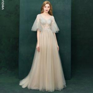 Luksus Champagne Gjennomsiktig Selskapskjoler 2019 Prinsesse V-Hals Bell ermer Beading Feie Tog Buste Ryggløse Formelle Kjoler