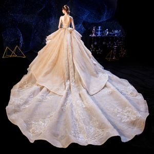 Luxury / Gorgeous Champagne Wedding Dresses 2020 Ball Gown Spaghetti Straps Sleeveless Backless Beading Appliques Lace Glitter Tulle Cathedral Train Ruffle