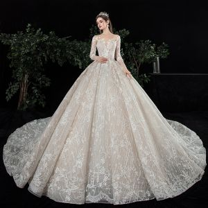 Charming Champagne See-through Wedding Dresses 2020 Ball Gown Scoop Neck Long Sleeve Backless Glitter Tulle Appliques Lace Beading Royal Train Ruffle