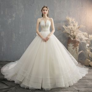 Charming Champagne Wedding Dresses 2019 A-Line / Princess Strapless Bow Sleeveless Backless Cathedral Train