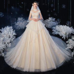 Vintage Champagne Brud Bröllopsklänningar 2020 Balklänning Genomskinliga Hög Hals Ärmlös Halterneck Appliqués Spets Chapel Train Ruffle