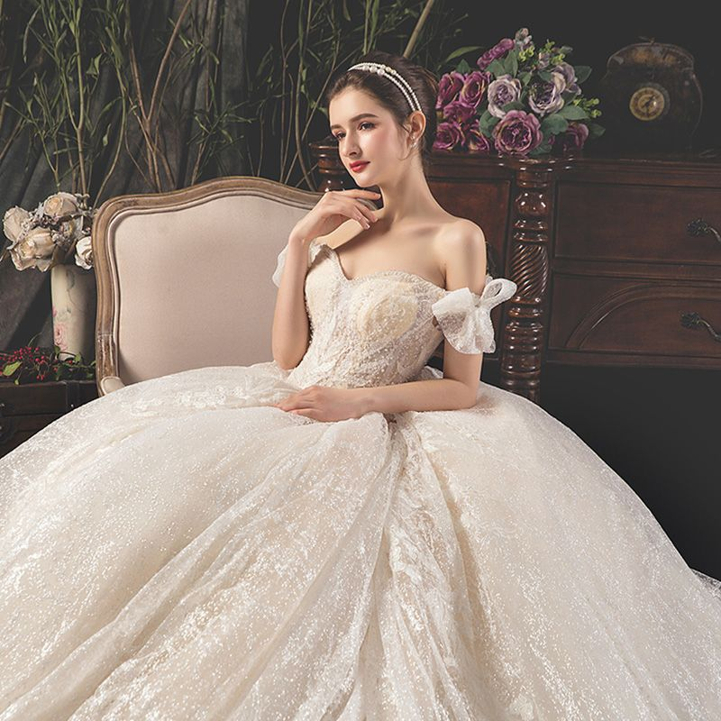 Best Champagne Wedding Dresses 2019 Ball Gown Off-The-Shoulder Bow Short Sleeve Backless Appliques Lace Beading Pearl Sequins Glitter Tulle Royal Train Ruffle