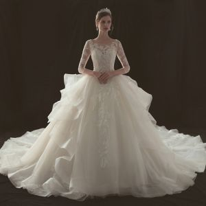 Illusion Champagne Pierced Wedding Dresses 2019 Ball Gown Scoop Neck 3/4 Sleeve Backless Appliques Lace Beading Cathedral Train Cascading Ruffles