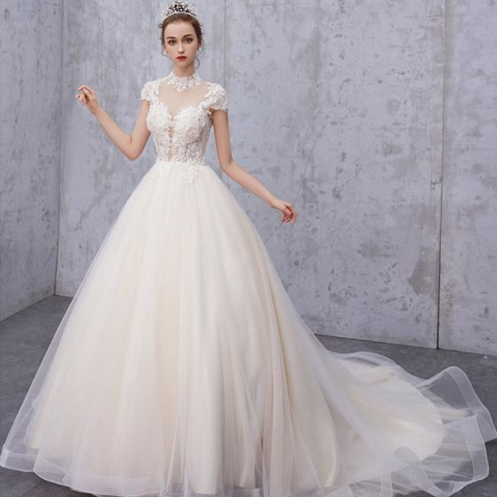 3347aa9c579 vintage-retro-champagne-see-through-wedding-dresses -2019-a-line-princess-high-neck-cap-sleeves-appliques-lace-beading-pearl- court-train-ruffle-560x560.jpg