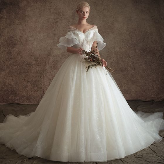 4b1a1fdba498 elegant-ivory-see-through-wedding-dresses-2019-a-line-princess-v-neck-bell -sleeves-backless-appliques-lace-beading-chapel-train-ruffle-560x560.jpg