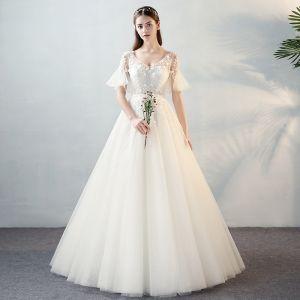 Modern / Fashion Ivory See-through Wedding Dresses 2018 A-Line / Princess V-Neck Short Sleeve Backless Beading Appliques Flower Bow Sash Ruffle Floor-Length / Long