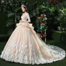 Stunning Champagne Pierced Wedding Dresses 2018 Ball Gown Scoop Neck Long Sleeve Backless Appliques Flower Pearl Ruffle Royal Train