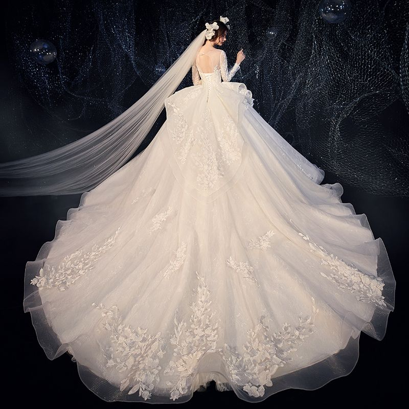 Charming Champagne See-through Wedding Dresses 2020 Ball Gown Scoop Neck Sleeveless Backless Pierced Appliques Lace Beading Glitter Tulle Cathedral Train Ruffle