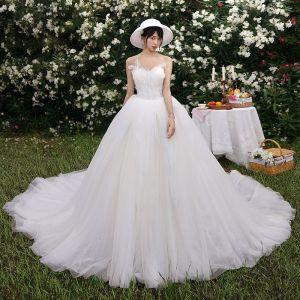 Modest / Simple Ivory Wedding Dresses 2019 Ball Gown Sweetheart Sleeveless Backless Beading Chapel Train Ruffle