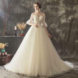 Illusion Champagne See-through Wedding Dresses 2019 A-Line / Princess Scoop Neck Bell sleeves Appliques Lace Pearl Glitter Tulle Court Train Ruffle