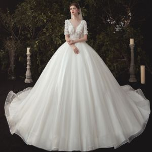 Elegant Ivory Wedding Dresses 2020 Ball Gown Deep V-Neck Pearl Lace Flower Appliques Short Sleeve Backless Cathedral Train