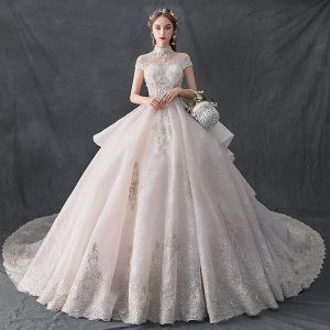 Luxury / Gorgeous Vintage / Retro Champagne See-through Wedding Dresses 2019 Ball Gown High Neck Cap Sleeves Backless Appliques Lace Handmade  Beading Cathedral Train Ruffle
