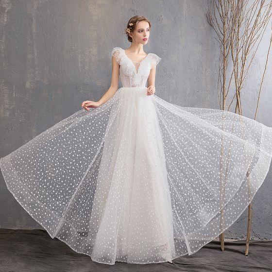 63d477c6bf0 chic-beautiful-ivory-beach-wedding-dresses-2019-a-line-princess-deep-v-neck -spotted-sleeveless-backless-floor-length-long-560x560.jpg
