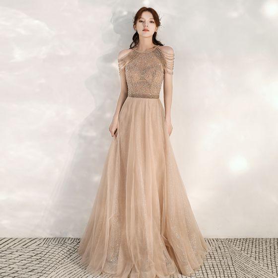 Eleganckie Złote Sukienki Wieczorowe 2020 Princessa Wycięciem Bez Rękawów Frezowanie Cekinami Tiulowe Długie Wzburzyć Bez Pleców Sukienki Wizytowe