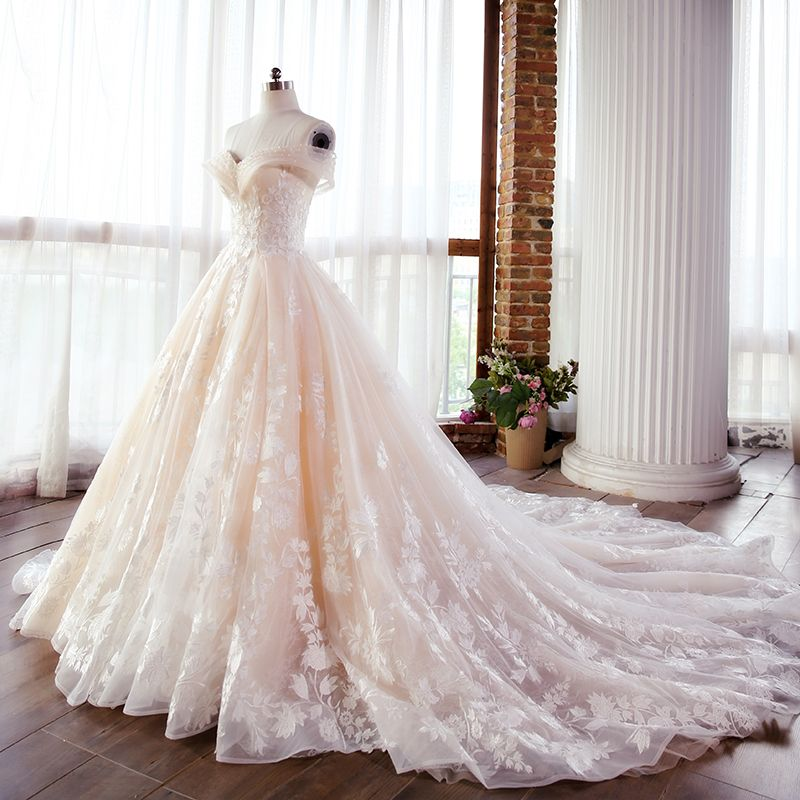 Elegant Champagne Wedding Dresses 2018 Ball Gown Lace Appliques Pearl Off-The-Shoulder Backless Sleeveless Cathedral Train Wedding