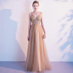 Elegante Champagner Gold Abendkleider 2020 A Linie Spaghettiträger Ärmellos Perlenstickerei Lange Rüschen Rückenfreies Festliche Kleider