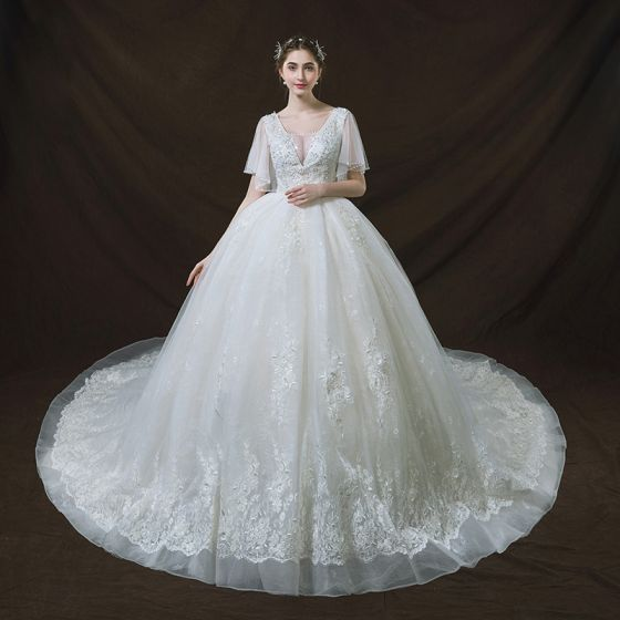 Chic / Beautiful Ivory Wedding Dresses 2018 Ball Gown See-through V-Neck Short Sleeve Backless Appliques Lace Sequins Pearl Royal Train Ruffle