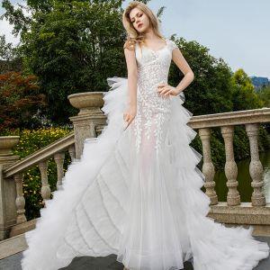 Sexy Weiß Brautkleider 2018 Mermaid Applikationen Mit Spitze Durchsichtige V-Ausschnitt Rückenfreies Ärmel Sweep / Pinsel Zug Hochzeit