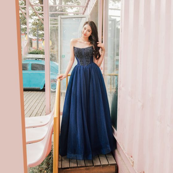 33bababeec classy-navy-blue-prom-dresses-2019-princess-amazing -unique-strapless-sleeveless-beading-floor-length-long-ruffle-backless- formal-dresses-560x560.jpg