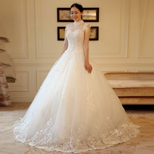 Luxury / Gorgeous Chinese style Ivory See-through Wedding Dresses 2018 A-Line / Princess High Neck Sleeveless Backless Appliques Lace Pearl Beading Ruffle Chapel Train