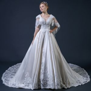 Vintage / Retro Champagne Wedding Dresses With Shawl 2018 Ball Gown V-Neck Backless Appliques Lace Beading Ruffle Cathedral Train