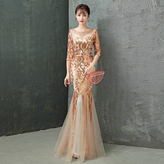 ac0437c2f0 Uroczy Złote Sukienki Wieczorowe 2019 Syrena   Rozkloszowane Wycięciem  Kryształ Cekiny 1 2 Rękawy Bez Pleców Długie Sukienki Wizytowe