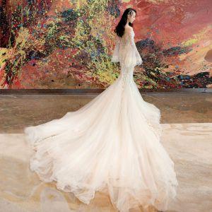 Sexy Champagner Brautkleider / Hochzeitskleider 2019 Meerjungfrau Off Shoulder Spitze Blumen Glanz Tülle Lange Ärmel Rückenfreies Kathedrale Schleppe