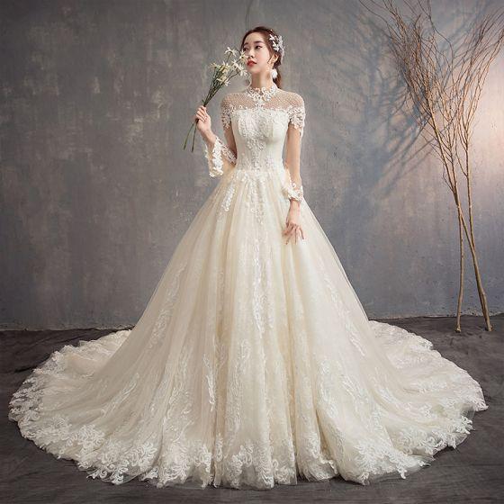 Mode Champagne Genomskinliga Bröllopsklänningar 2019 Prinsessa Hög Hals Långärmad Halterneck Appliqués Spets Beading Glittriga / Glitter Tyll Cathedral Train Ruffle