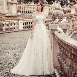 Schöne Champagner Brautkleider / Hochzeitskleider 2019 A Linie Off Shoulder Star Perlenstickerei Spitze Blumen Kurze Ärmel Rückenfreies Lange