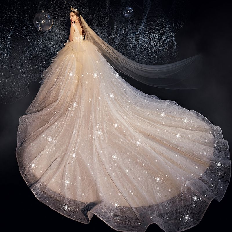 Bling Bling Champagne Robe De Mariée 2019 Robe Boule Col v profond Sans Manches Dos Nu Glitter Tulle Volants Cathedral Train