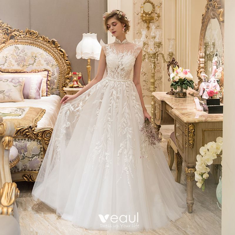 Illusion Ivory See Through Wedding Dresses 2019 A Line Princess High Neck Sleeveless Pierced Appliques Lace Beading Sweep Train Ruffle